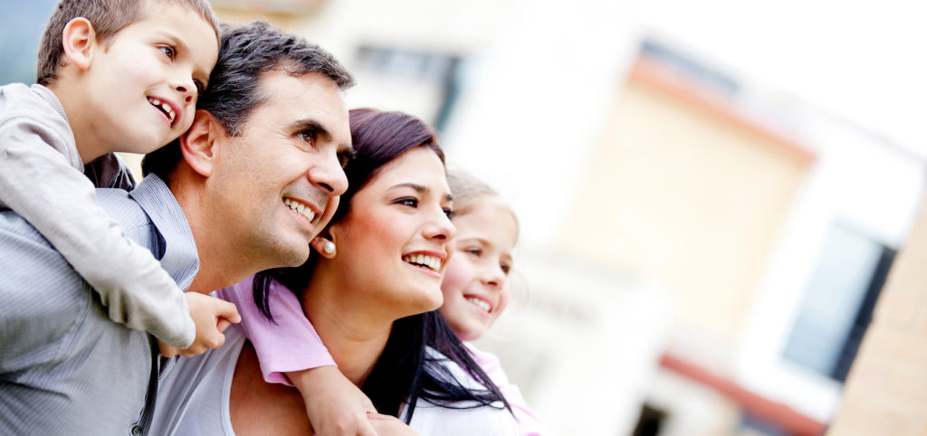 Family looking at their home they wish to sell